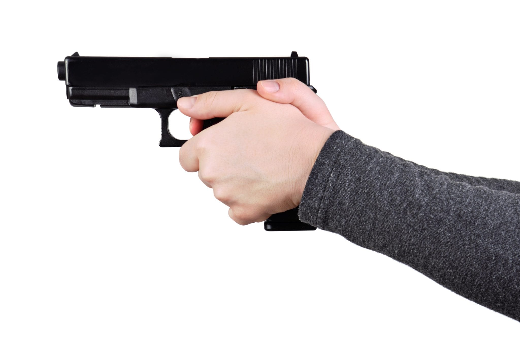 Close up of female hands aiming gun on a white background