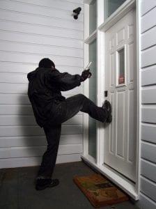 Woman Kills Jail Escapee Who's Kicking In Her Door
